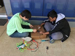students completing science project